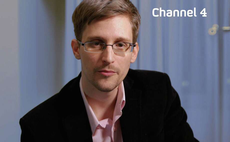 "A recent, undated handout picture received from Channel 4 on December 24, 2013 shows US intelligence leaker Edward Snowden preparing to make his television Christmas message. US intelligence leaker Edward Snowden will call on citizens to work together to end mass surveillance when he delivers a Christmas Day broadcast to Britain, the Channel 4 television network said on Tuesday. In his first television appearance since claiming asylum in Russia, Snowden, who caused shockwaves around the world by revealing mass US electronic surveillance programmes, will give a staunch defence of privacy in the short pre-recorded broadcast. AFP PHOTO / CHANNEL 4  RESTRICTED TO EDITORIAL USE - MANDATORY CREDIT "" AFP PHOTO / CHANNEL 4"" - NO MARKETING NO ADVERTISING CAMPAIGNS - DISTRIBUTED AS A SERVICE TO CLIENTSCHANNEL 4/AFP/Getty Images Photo: CHANNEL 4, Handout / AFP"