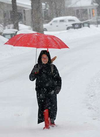 Janet Reilly of Guilderland uses an umbrella as she walks down Norwood St. in a snow storm on Thursday, Jan. 2, 2014 in Guilderland, N.Y. (Lori Van Buren / Times Union) Photo: Lori Van Buren / 00025207A