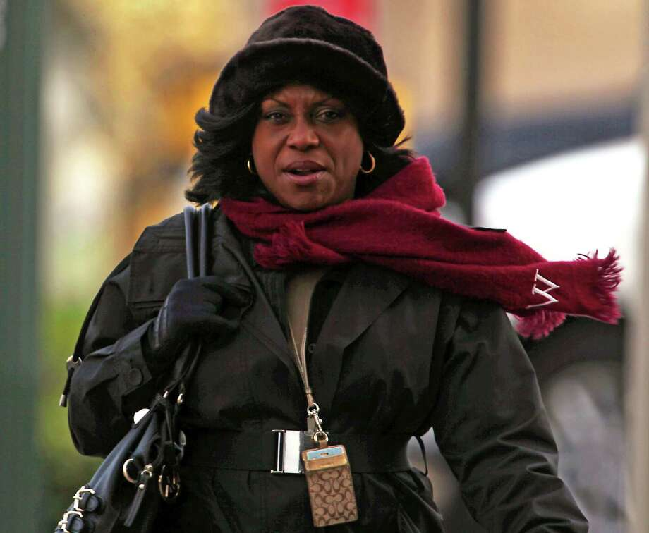 Wanda Gray endures the cold, blustery winds as she walks near Preston and Milam on Thursday. The big chill will continue through the weekend, but Houston is better off than most of the country. Photo: James Nielsen, Staff / © 2013  Houston Chronicle