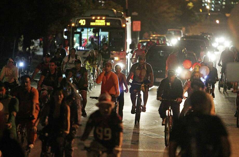 Thousands of bicyclists pedal down Houston Avenue during the Critical Mass bike ride last October. Photo: James Nielsen, Staff / © 2013  Houston Chronicle