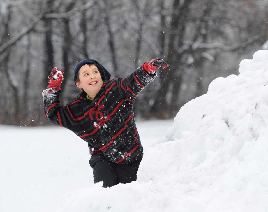 Kacper Gravowski, 10, puts a snowball to good use in Byram Park in Greenwich. Photo: Bob Luckey, Greenwich Time