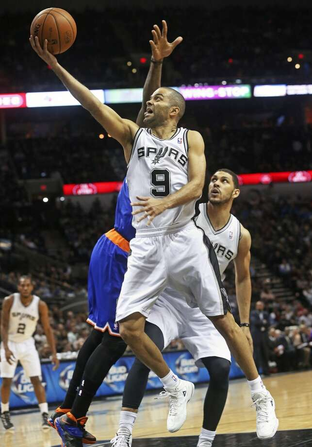 Tony Parker reaches in for a layup in the first half as the Spurs host the New York Knicks at the AT&T Center on January 2, 2014.