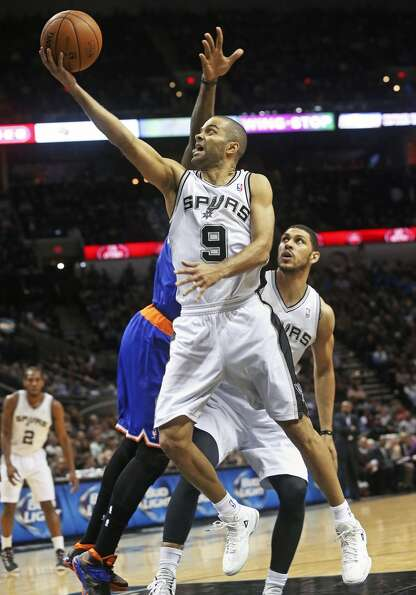 Tony Parker reaches in for a layup in the first half as ...