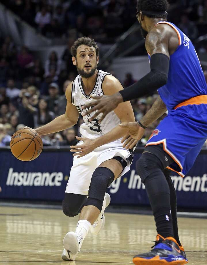 Marco Belinelli leads the offense as the Spurs host the New York Knicks at the AT&T Center on January 2, 2014.