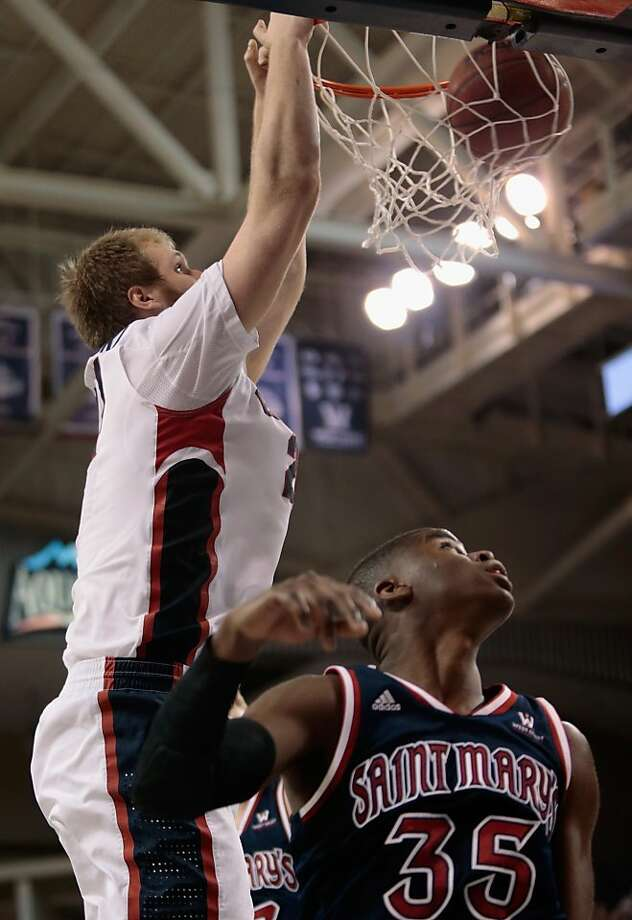 Gonzaga's 7-foot-1 Przemek Karnowski, who scored 15 points, dunks over guard James Walker III of St. Mary's. Photo: William Mancebo, Getty Images