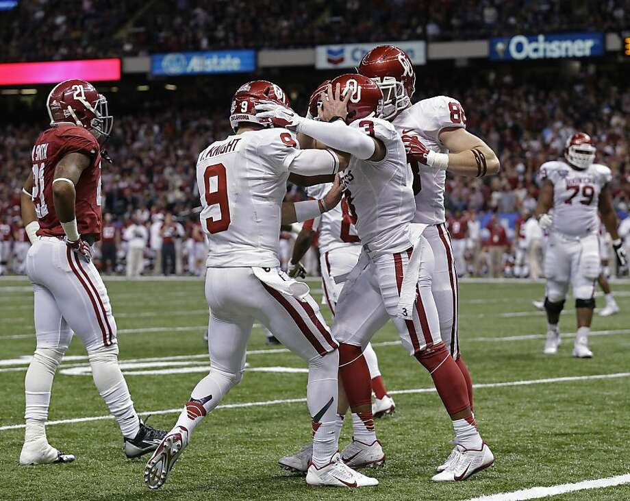 Oklahoma quarterback Trevor Knight (9) and wide receiver Sterling Shepard celebrate a touchdown. Photo: Rusty Costanza, Associated Press