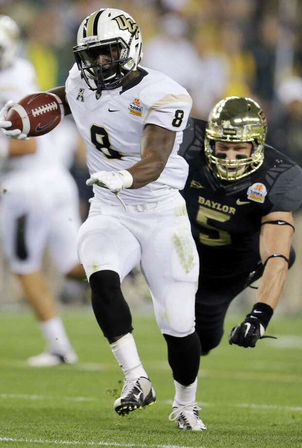 Running back Storm Johnson and Central Florida blew past Eddie Lackey and Baylor in a Fiesta Bowl upset win. Photo: Matt York / Associated Press / AP