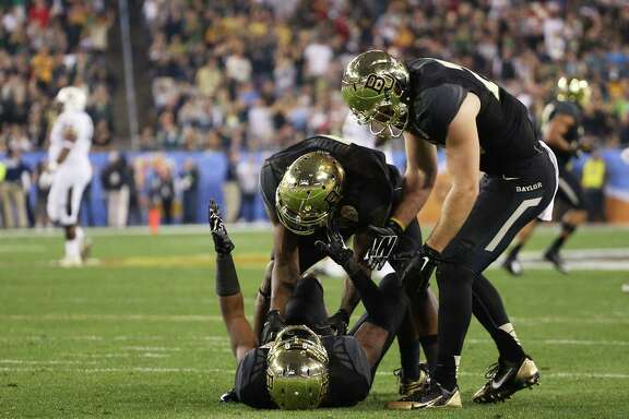 GLENDALE, AZ - JANUARY 01:  Demetri Goodson #3 of the Baylor Bears celebrates with teammates after his second quarter interception against the UCF Knights during the Tostitos Fiesta Bowl at University of Phoenix Stadium on January 1, 2014 in Glendale, Arizona.  (Photo by Christian Petersen/Getty Images)