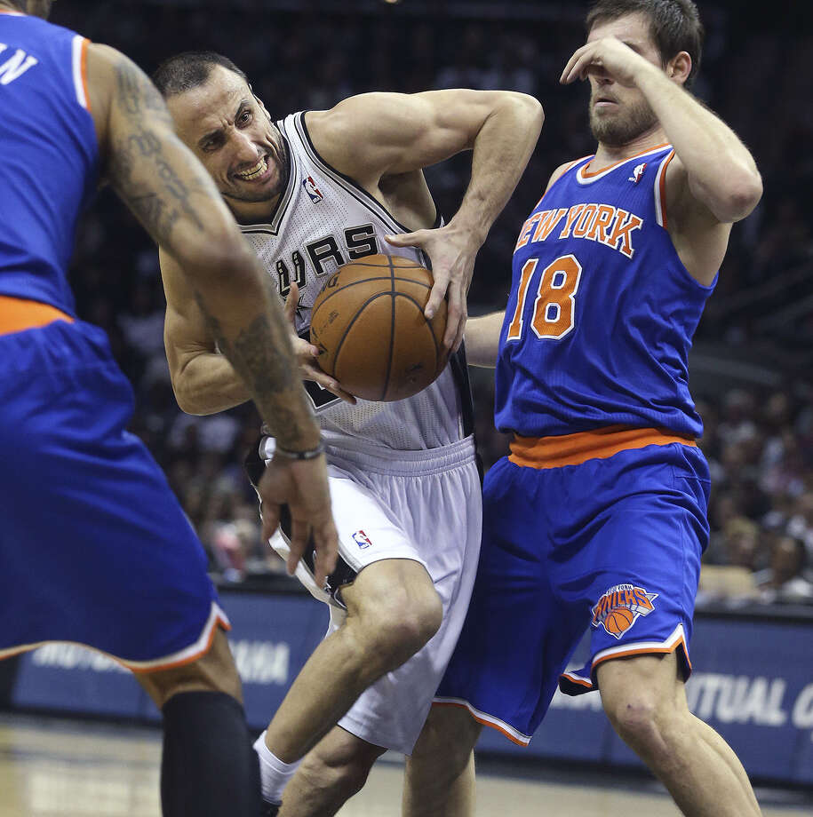 Manu Ginobili had 11 points and 12 assists, but ex-Spur Beno Udrih (right) and the Knicks claimed victory at the AT&T Center. Photo: TOM REEL