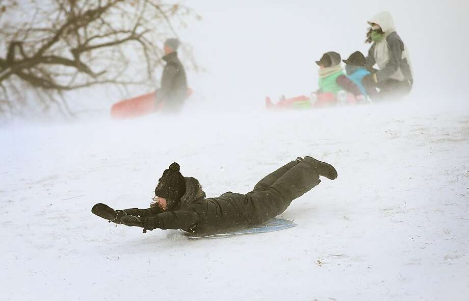 CHICAGO, IL - JANUARY 02:  A kid goes down a hill on a sled in Humboldt Park on January 2, 2014 in Chicago, Illinois. The Chicago area has been getting snowed on for the past three days with some suburban areas getting hit with more than 16 inches. The snowfall is expected to end sometime this evening or early Friday morning in the city. The same system is moving east and is expected to dump more than a foot of snow in areas of New England.  (Photo by Scott Olson/Getty Images) Photo: Scott Olson, Getty Images