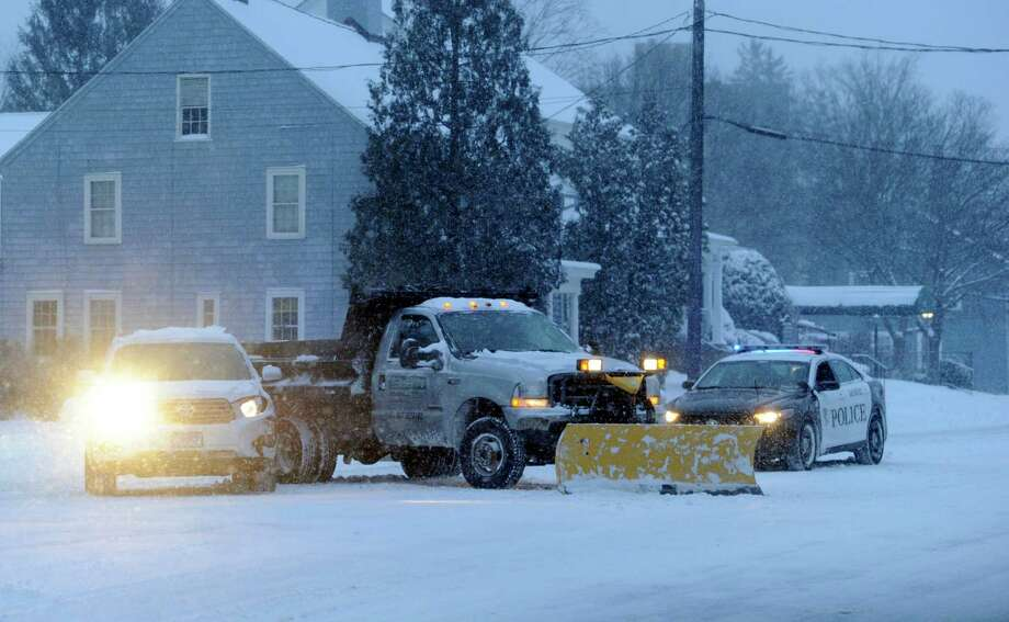 A car and a snow plow truck collide on Main Street in Danbury, Conn. Friday, Jan. 3, 2013. Photo: Carol Kaliff / The News-Times