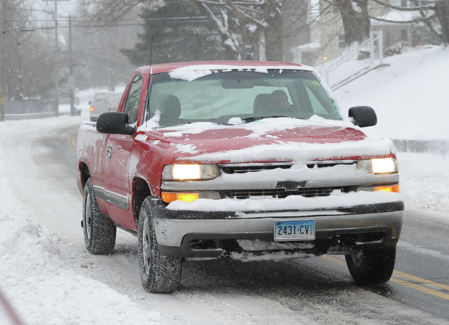 A vehicle heads south on Byram Road during the snow storm that hit Greenwich, Conn., Friday morning, Jan. 3, 2014. Photo: Bob Luckey / Greenwich Time