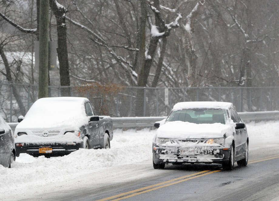 A car heads south on Byram Road during the snow storm that hit Greenwich, Conn., Friday morning, Jan. 3, 2014. Photo: Bob Luckey / Greenwich Time