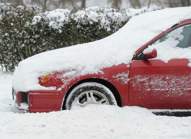 A car parked on Byram Road covered in snow during the snow storm that hit Greenwich, Conn., Friday morning, Jan. 3, 2014. Photo: Bob Luckey / Greenwich Time