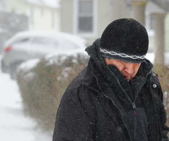 A man walks along Byram Road during the snow storm that hit Greenwich, Conn., Friday morning, Jan. 3, 2014. Photo: Bob Luckey / Greenwich Time