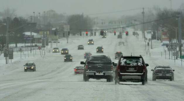Snow covered roads made traveling difficult in Colonie on Friday. (Skip Dickstein / Times Union)