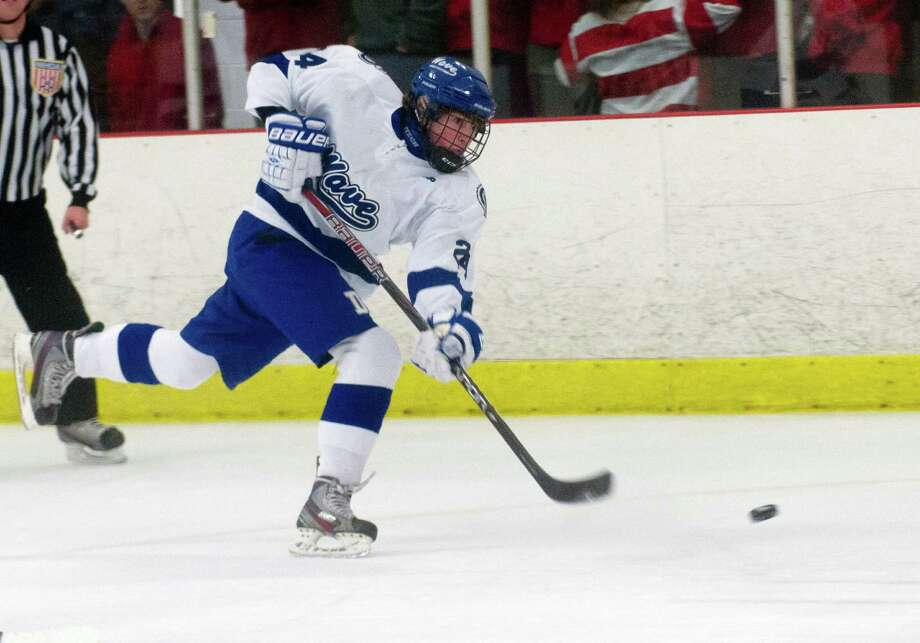Darien's Dillon Fitzpatrick takes a shot during Saturday's boys hockey game against New Canaan at the Darien Ice Rink in Darien, Conn., on December 28, 2013. Photo: Lindsay Perry / Stamford Advocate