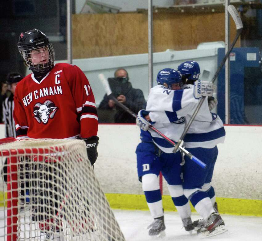 Darien players celebrate a goal during Saturday's boys hockey game at the Darien Ice Rink in Darien, Conn., on December 28, 2013.