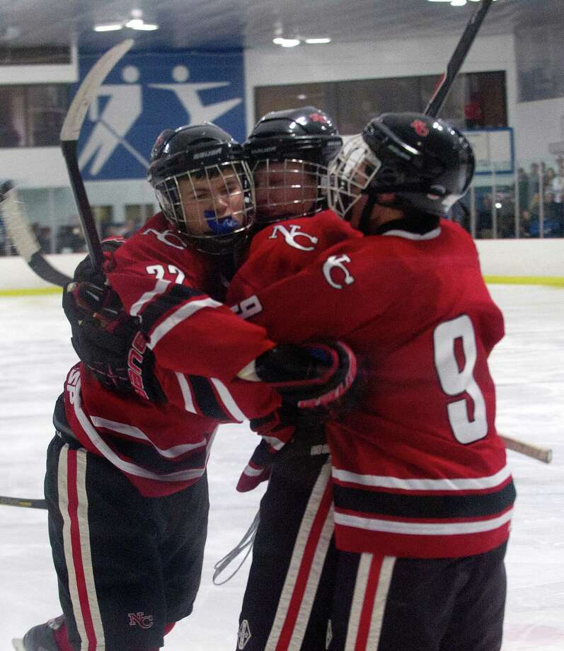 New Canaan players celebrate a goal during Saturday's boys hockey game at the Darien Ice Rink in Darien, Conn., on December 28, 2013. Photo: Lindsay Perry / Stamford Advocate