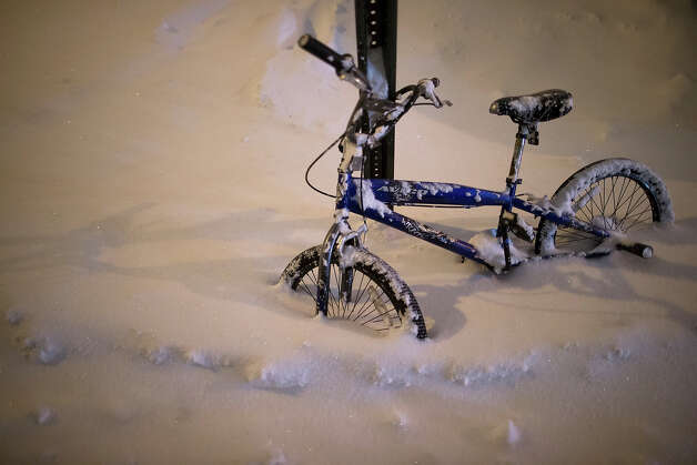 A bicycle is buried by overnight sno