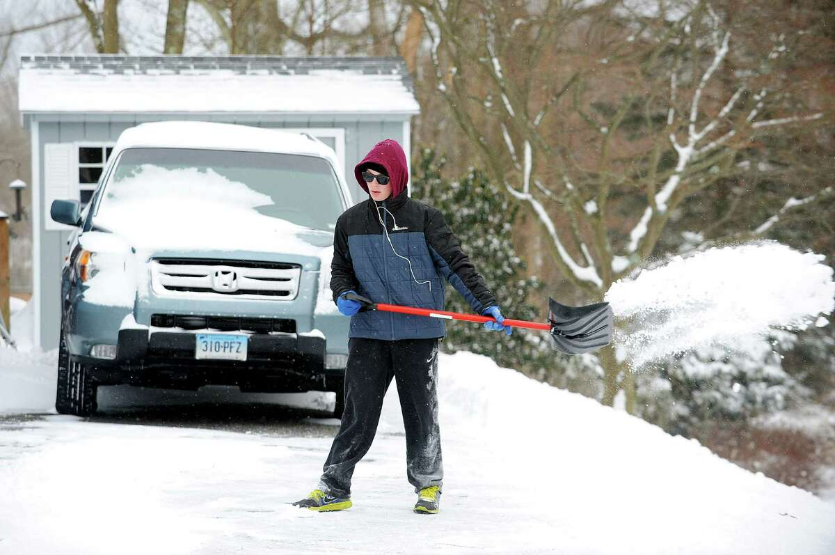 Cameron Thomas shovels his Tuckahoe Lane driveway after an overnight storm dumped about 6 inches of snow in Fairfield, Conn. on Friday, Jan. 3, 2014.