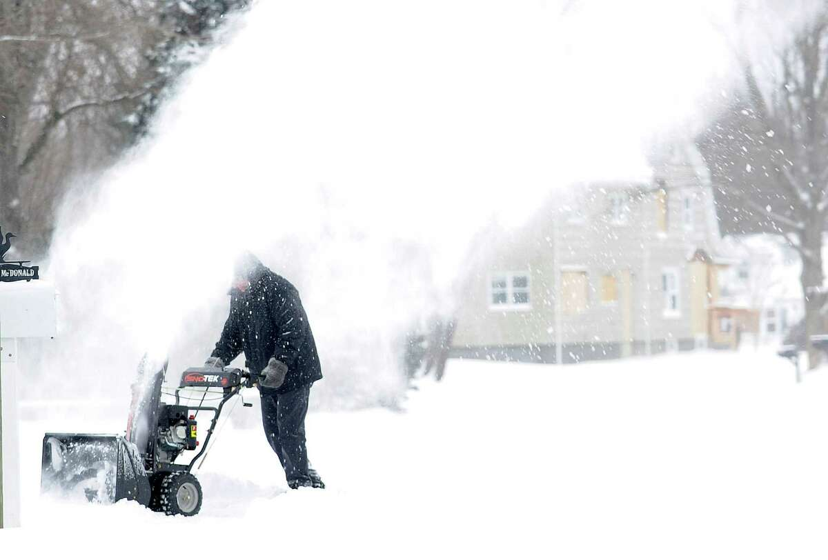 Residents start to dig out after an overnight snow storm in Fairfield, Conn. on Friday, Jan. 3, 2014.