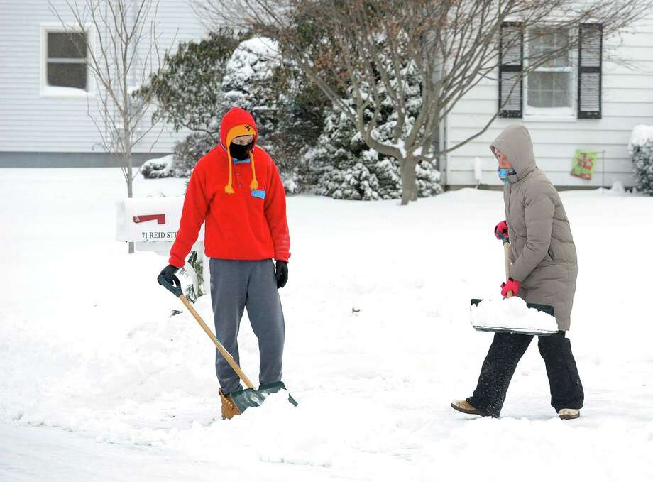 Residents start to dig out after an overnight snow storm in Fairfield, Conn. on Friday, Jan. 3, 2014. Photo: Cathy Zuraw / Connecticut Post