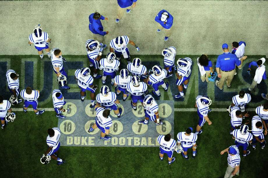 Members of the Duke Blue Devils huddle on the sidelines during the Chick-Fil-A Bowl against the Texas A&M Aggies at the Georgia Dome on December 31, 2013 in Atlanta, Georgia. Texas A&M defeated Duke 52-48. Photo: Scott Cunningham, Getty Images / 2013 Scott Cunningham