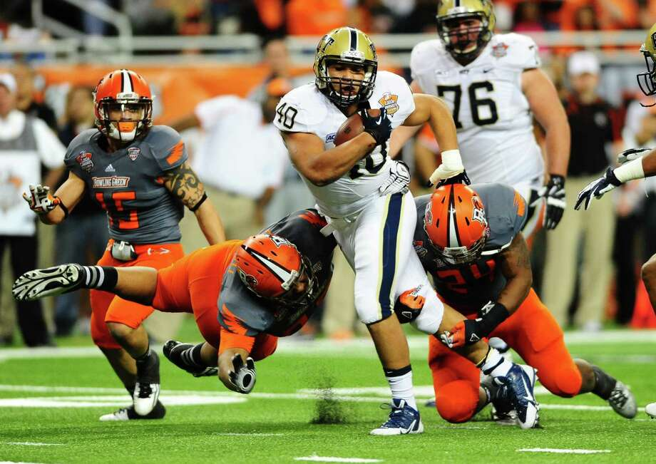 Running back James Conner #40 of the Pittsburgh Panthers runs the football runs the football during a game against the Bowling Green Falcons during the Little Caesars Pizza Bowl at Ford Field. The Panthers won 30-27. Photo: Diamond Images, Getty Images / 2013 Diamond Images
