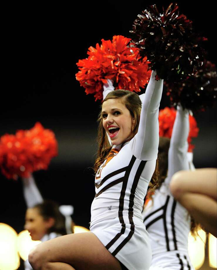 A cheerleader for the Bowling Green Falcons cheers on the sideline during a game between the Pittsburgh Panthers and Bowling Green Falcons during the Little Caesars Pizza Bowl at Ford Field. The Panthers won 30-27. Photo: Diamond Images, Getty Images / 2013 Diamond Images