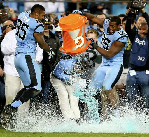 Teammates Kareem Martin #95 and Eric Ebron #85 of the North Carolina Tar Heels celebrate as they dunk head coach Larry Fedora with Gatorade after defeating the Cincinnati Bearcats 39-17 at Bank of America Stadium on December 28, 2013 in Charlotte, North Carolina. Photo: Streeter Lecka, Getty Images / 2013 Getty Images
