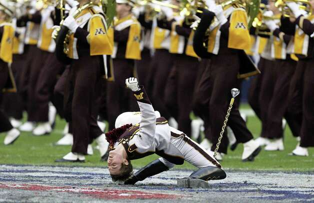 Minnesota Golden Gophers drum major brings the band onto the field at Reliant Stadium on December 27, 2013 in Houston, Texas. Photo: Bob Levey, Getty Images / 2013 Getty Images