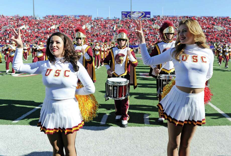 USC Trojans Song Girls Alexa Trujillo (L) and Perry Mattfeld perform with the USC marching band before the team's game against the Fresno State Bulldogs in the Royal Purple Las Vegas Bowl at Sam Boyd Stadium on December 21, 2013 in Las Vegas, Nevada. USC won 45-20. Photo: Ethan Miller, Getty Images / 2013 Getty Images