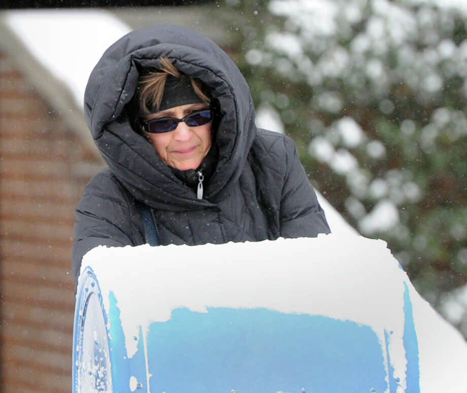 A woman mails a letter on Field Point Road during the snow storm that hit Greenwich, Conn., Friday morning, Jan. 3, 2014. Photo: Bob Luckey / Greenwich Time