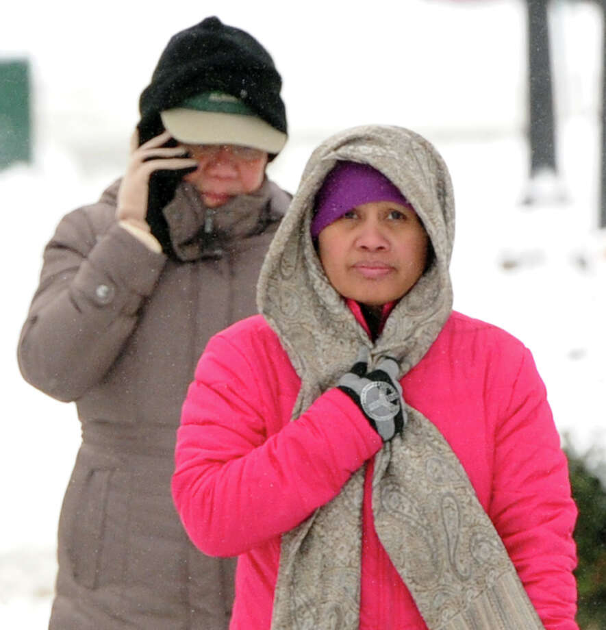 At right, Marybeth Oficier of Greenwich wears a long scarf while out on Greenwich Avenue during the snow storm that hit Greenwich, Conn., Friday morning, Jan. 3, 2014. Photo: Bob Luckey / Greenwich Time