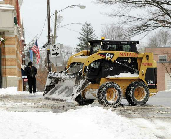 Snow clearing on Elm Street during the storm that hit Greenwich, Conn., Friday morning, Jan. 3, 2014. Photo: Bob Luckey / Greenwich Time