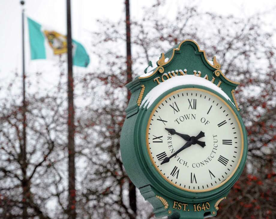 A snow-covered clock in front of Greenwich Town Hall during the storm that hit Greenwich, Conn., Friday morning, Jan. 3, 2014. Photo: Bob Luckey / Greenwich Time