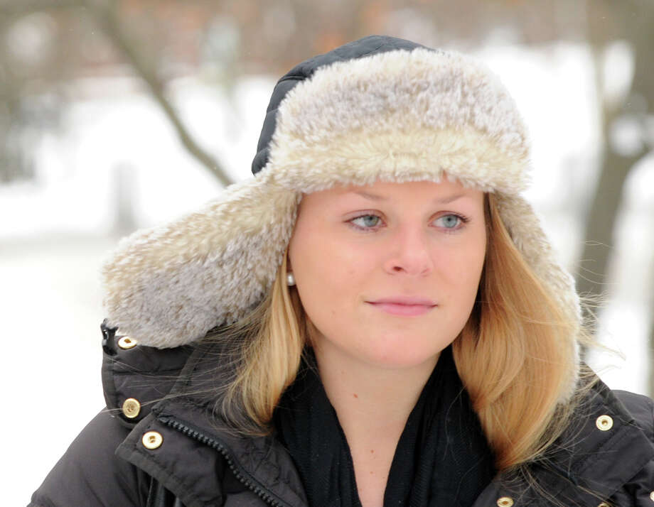 A woman wears a winter hat while out on Greenwich Avenue during the snow storm that hit Greenwich, Conn., Friday morning, Jan. 3, 2014. Photo: Bob Luckey / Greenwich Time