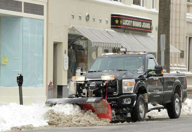 A plow clears snow from Greenwich Avenue during the snow storm that hit Greenwich, Conn., Friday morning, Jan. 3, 2014. Photo: Bob Luckey / Greenwich Time