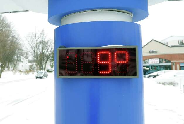 9 degrees reads the sign in front of Splash Car Wash on West Putnam Avenue during the snow storm that hit Greenwich, Conn., Friday morning, Jan. 3, 2014. Photo: Bob Luckey / Greenwich Time