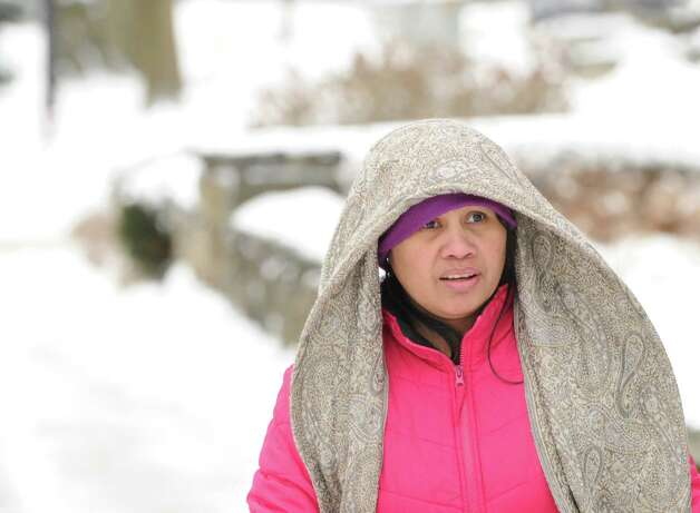 Marybeth Oficier of Greenwich wears a long scarf while out on Greenwich Avenue during the snow storm that hit Greenwich, Conn., Friday morning, Jan. 3, 2014. Photo: Bob Luckey / Greenwich Time