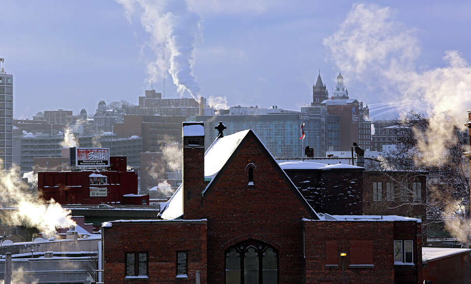 Subzero temperatures were recorded in Central New York Friday, Jan. 3, 2014, as steam pours out of chimneys in downtown Syracuse, N.Y. Photo: Dick Blume, AP / The Post-Standard