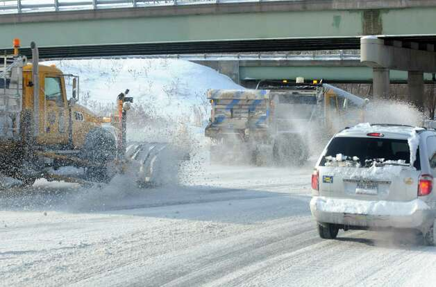 A vehicle stops at the end of the on ramp as a tandem of plows clear the I-90 roadway on Friday Jan. 3, 2014 in Albany , N.Y. (Michael P. Farrell/Times Union) Photo: Michael P. Farrell / 00025215A
