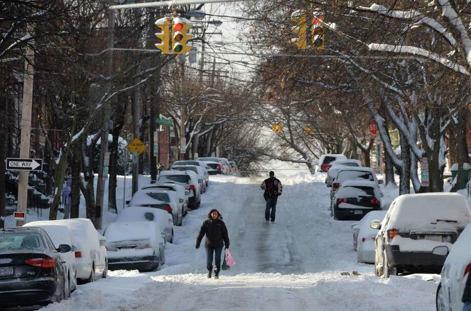 Lordes Santana walks down the center of Dove Street due to the heavy amount of snow on the sidewalks after another major snow fall his the area Friday Jan. 3, 2013 in Albany, N.Y.   (Skip Dickstein / Times Union) Photo: SKIP DICKSTEIN