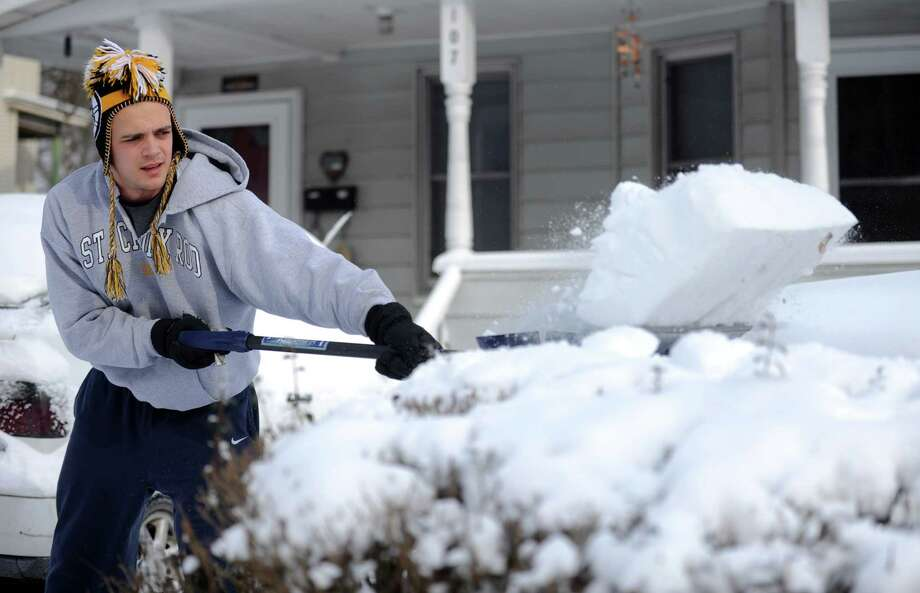 Andrew Pattyson shovels the driveway at his home in Ansonia, Conn. Friday, Jan. 3, 2014. Photo: Autumn Driscoll / Connecticut Post