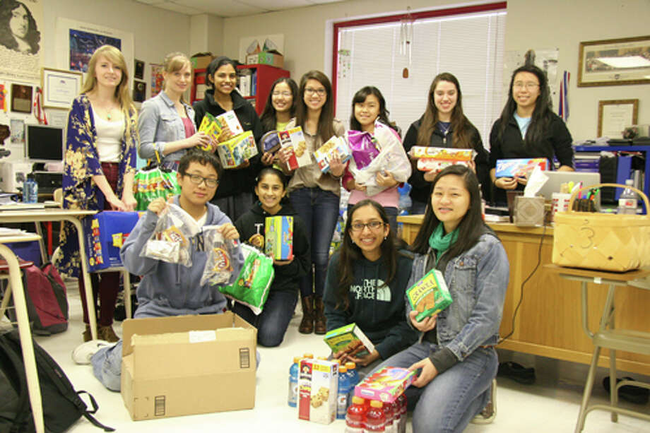 Bellaire High School Cancer Awareness Club members and their care packages. Photo: Bellaire High School Photo