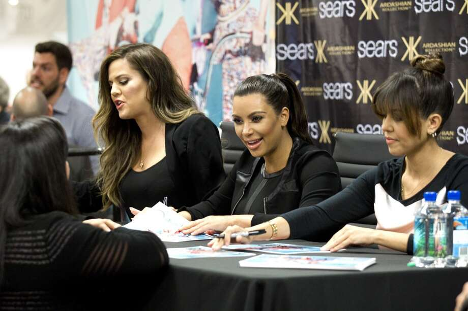 Khloe, left, Kim and Kourtney Kardashian signed autographs while promoting their fashion line at Willowbrook Mall in May. Photo: Brett Coomer, Houston Chronicle