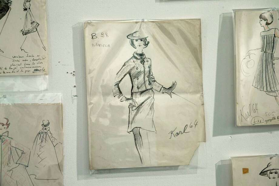 One of the few signed drawings that Karl Lagerfeld did hangs on the wall of the Modern Auction house in West Palm Beach, Fla. A 50-year-old archive of some of Lagerfeld's early fashion designs is going up for auction. Photo: J Pat Carter, STF / AP