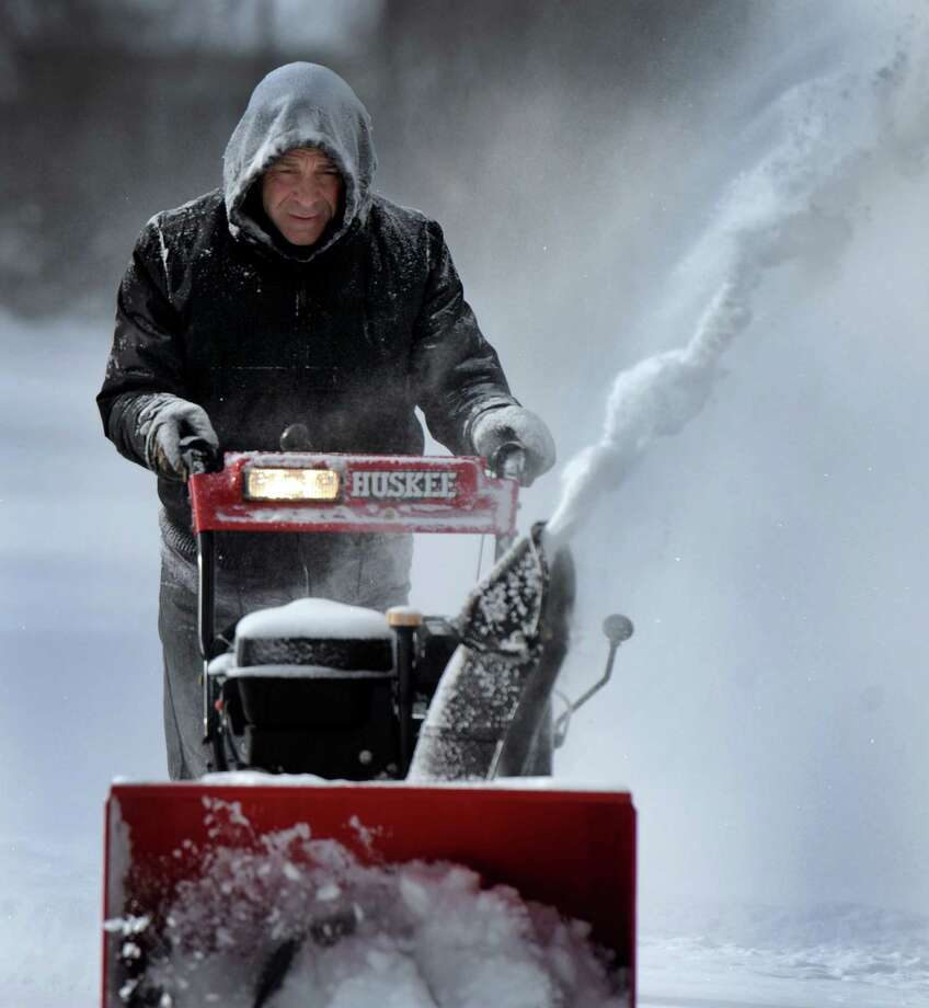 Paul Capichiano, snowblows his driveway on Curtis Avenue in New Fairfield, Conn., after an overnight snowfall, Friday, Jan. 3, 2014. Photo: Carol Kaliff / The News-Times