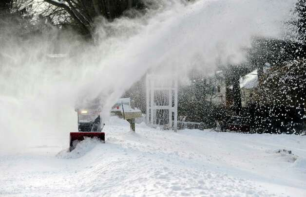 Paul Capichiano's sight is obscured by the blowing snow as he clears his property on Curtis Avenue in New Fairfield, Friday, Jan. 3, 2014. Photo: Carol Kaliff / The News-Times